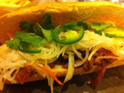 Spicy BBQ Pork Banh Mi from Del Seoul I've had many banh mi before and I can easily admit that this one from Del Seoul was the BEST!  I think it's a combination of the fact that they pickle their daikon and carrot slaw, there is a red pepper aioli spread on the baguette AND their meat was marinated to flavorful perfection.  I also had a taste of their kimchi and a steamed dumpling… both of which were delicious!  Try this place out if you're in the mood for Korean street food.