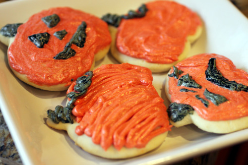 Grandma Wellard's Delicious Soft Sugar Cookies- Halloween Edition  Cookie Directions- 1. Cream together- 1 cup butter2 cups sugar3 eggs 2. Add to this mixture- 1 cup sour cream2 tsp baking powder1 tsp baking soda 3. Slowly add- 6 cups flour, or enough to get the right consistency. 4. Roll out 1/4 inch thick. Using as little as flour as possible, cut out different shapes. 5. Bake on an ungreased cookie sheet at 350 degrees for 8-10 minutes or until bottoms are golden brown. 6. Cool on wire rack & then decorate with buttercream icing.   Steven rolled them a little thicker, which is fine by me.  Naked Ghost! Buttercream Icing directions- 1. Cream together- 2 cups powdered sugar1/4 cup shortening1/4 cup butter (softened)1/2 tsp vanilla1 T milkAssorted food coloring 2. Divide into different containers or ziploc bags to pipe, add desired colors, and decorate cookies.    In honor of Breast Cancer Awareness month!  These cookies always get compliments.
