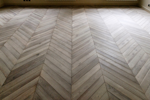 cuteandcomfortable:     chevron wood floors. beautiful.   by atdg   I want the floor of my future home office to look just like that. I will take the big bright windows too!