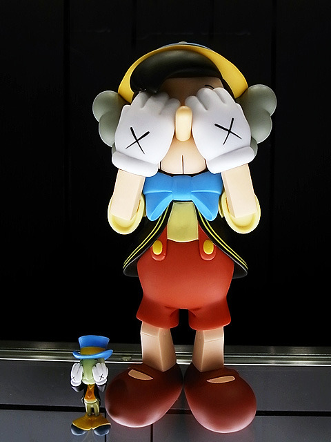 OriginalFake x Medicom Toy Pinocchio and Jiminy Cricket It's the first time I've wanted Disney memorabilia since I was…well, nevermind the age. At least the signature Kaws' skull head and crosses won't make you feel like you just skipped out of the Magic Kingdom. kawsone.com