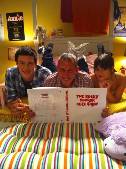 "Cory Monteith, ""The Rocky Horror Glee Show"" director Adam Shankman, and Lea Michele on the set of Glee. I hope that there's actually going to be some tranny fierceness in next week's episode of Glee. I think many people expected Kurt to be Dr. Frank N. Furter, but it appears that Mercedes will be filling the role of Sweet Transvestite,  presumably because Fox didn't want Carl (Emma's dentist boyfriend/John  Stamos' character) to be a trannylicious man-lady. Aside from this, the episode seems fairly promising, especially since they've managed to bring in Meat Loaf and Barry Bostwick!"
