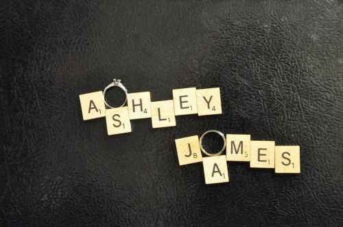 Ashley & James scrabble pieces. With my engagement ring and James' wedding band. They're magnet pieces on the fridge.