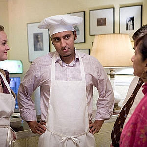 This is Aasif Mandvi. He is a Muslim wearing a chef's hat.