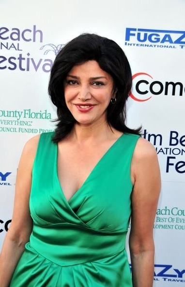 This is Shohreh Aghdashloo. She is Muslim and she is wearing a glorious green dress.