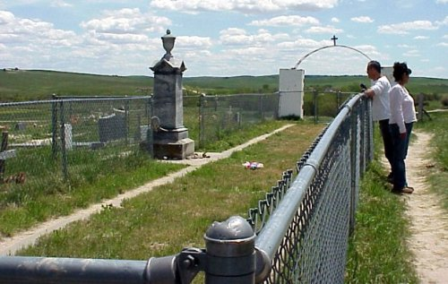 saltmarsh:  Mass grave at the site of the 1890 Wounded Knee Massacre. [Wikipedia link. Wikipedia has another photo of the frozen Lakota bodies being shoveled into the mass grave, if you want to see it.] Today in my Native American Literature course we reviewed Charles Eastman's reportage of the massacre from his post as doctor at the nearby Pine Ridge Reservation. I've taught this course several times at this college in suburban Long Island, and most of the negative attitudes I've encountered from students have been related to their FOX-news informed notions that Indians don't pay enough taxes. (This argument always amazes me because, hello - Indians already lost almost the entire continent, but whatever.) Today, in a new low, students defended the Wounded Knee Massacre as a justifiable military operation. They felt that the Ghost Dance was a lot of creepy chanting and that during a time of war, free speech (Ghost Dancing) is not allowed. They felt that it was very wrong to blame the Seventh Cavalry because the soldiers must have been traumatized by their service throughout the Indian Wars. Most of all they found it wrong to question the actions of the United States in any wartime situation, past or present. The conversation made me feel sad for this country.