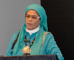 Here we have Amina Wadud. She's Muslim and she likes to wear medallions.
