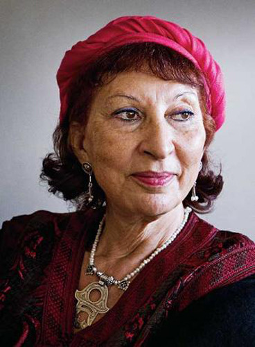 Fatima Mernissi, who is also Muslim, is wearing red lipstick and a red hat.