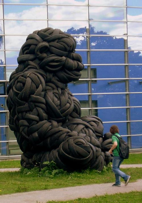 "thisisliv:  Ladies and Gentleman - A Rubber Gorilla  This amazing work of art by sculptor Villu Jaanisoo, entitled ""Kaikki on mahdollista"" (Everything is Possible, 2009) is a gigantic gorilla made of second-hand car tires. The sculpture won an invitational art competition arranged by the State Art Collection, which operates in conjunction with the Arts Council of Finland. It is located on Viikinkaari and the University of Helsinki's science library can be seen in the background. Helsinki Finland Photo By Debarshi Ray (via scandinaviansky)"