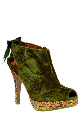 A Many-Spendored Thing Heel: $129.99 Algae on the top, funfetti cupcake on the bottom. In the morning mist, two luxe elements, velvet and sparkles, kissed,   and the world stood still as this bold, jaw-dropping peep toe heel, by  Poetic License, fantastically formed! Like your favorite song of love,  this amazing platform heel will make you giddy with glee.