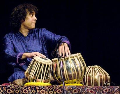 Tabla master Zakir Hussain usually wears a kurta, and can wear out a pair of drums like nobody's business.