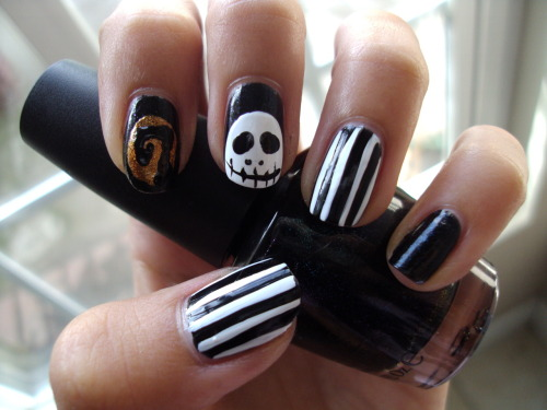 "stephanieanguyen:  Halloween 'Nightmare Before Christmas' Nails!!! Striped nails: OPI's Black Onyx and a white nail striperAll other nails have OPI's Unripened as a base. OPI's Alpine Snow and a black nail striper was used for Jack Skellington, OPI's Rising Star as the orange ""moon"" background on the index finger. I should've drawn Jack on top of the cliff, but i ran out of room. Maybe you guys could learn from my mistake and draw him on top? =) Happy almost Halloween!"