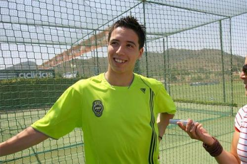 Samir Nasri is wearing a kind of fluorescent bright lime-green garb that only a few Muslims can successfully pull off. Samir seems pretty confident he rocks this color of Muslim garb.