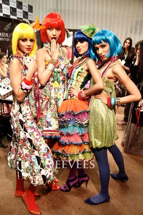 Pakistani supermodel Rubya Chaudhry (in orange wig) is going for shabby chic Muslim.