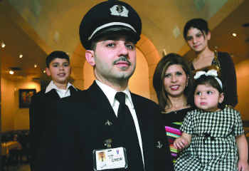 Pilot Mazin Shalabi, shown here with his family, wears a uniform and ID card that allows him to get on a commercial airliner — and then fly it safely to its destination.  He is a highly qualified pilot, that just so happens to be Muslim.