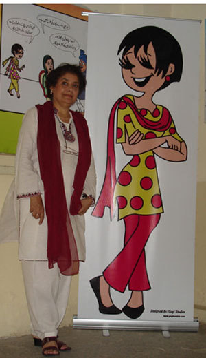 "Nigar Nazar and her creation ""Gogi"" are both fabulously accessorized in red."