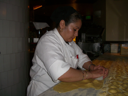 A woman making ravioli