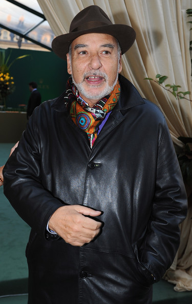 Tahar Ben Jelloun is a snazzy Muslim in a fedora and colorful ascot.