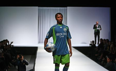 Seattle Sounders midfielder Sanna Nyassi models his newly designed Muslim soccer garb for the fans.