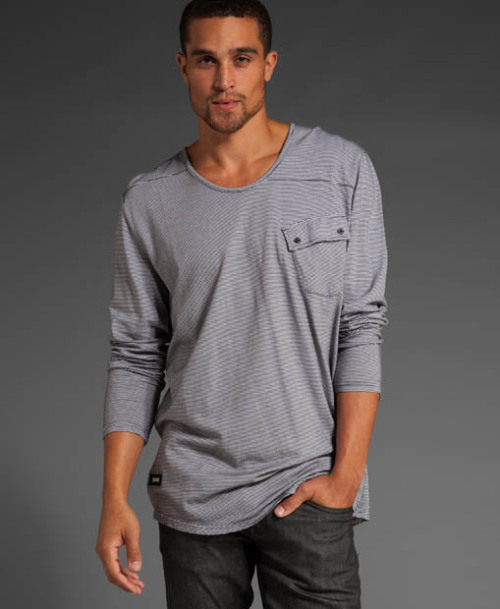 COMUNE CLOTHING / CONRAD LONG-SLEEVE SCOOP NECK Launched in 2009, Comune mixes art, skate and music influences into a line of street-inspired clothing with a quiet edge. We especially like the Conrad Long Sleeve Scoop Neck shirt.  It's a pretty interesting take on a simple casual sweater.  The front pocket is a great touch.  The shirt comes in black or dark charcoal. Here are a few other looks from Comune's current collection.    To learn more about Comune, visit the label's website.  You can also follow Comune on Facebook. $48