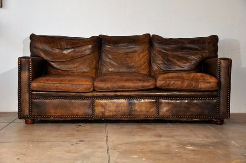 I am obsessed with this couch. Obsessed. It has character, and it's leather, but it's not pretentious.