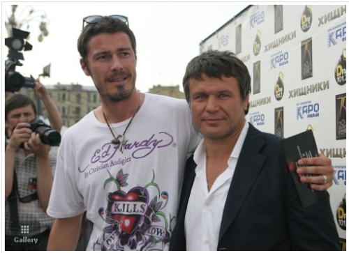 That's Marat Safin on the left. Something really needs to be done about all these Muslims wearing Ed Hardy. This garb is unacceptable for Muslims and all people. (previously)