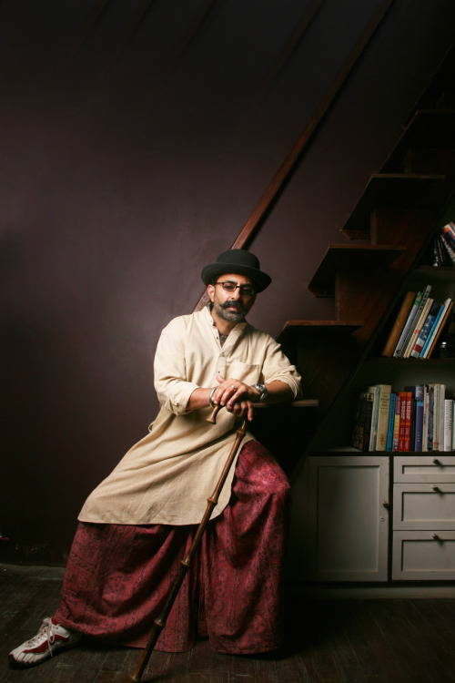 Yousuf Bashir Qureshi dresses in a dhoti and a kurta wherever he goes. And of course, a traditional pair of red and white sneakers.