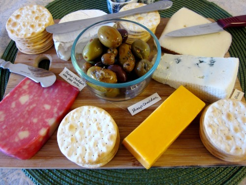 "Drew's parents came to visit, and I made them a cheese plate using the cheese I had laying around in my fridge. There were some leftovers, but my book club polished them off. My grocery list says ""cheeses, assorted."""