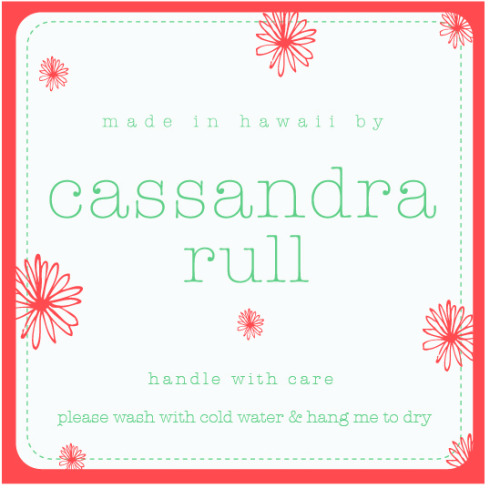 My best friend Cassandra Rull is a clothing designer back home in Hawaii. She is extremely talented and is a self taught seamstress.  Almost everyday, she slaves away creating all original garments from dresses to really comfy shorts with the softest fabrics. I love bragging about her to people because i know there is only great things to come for her in the future.  She and I have worked together on a few projects for her clothes from clothing tags to a mock up summer catalog I designed for a student project that you can check out here on my website. The latest project we got going on is a clothing tag to sew on the clothing itself. Here is the beginning stages of the tag and Im liking the direction its going…and hope you like it too!