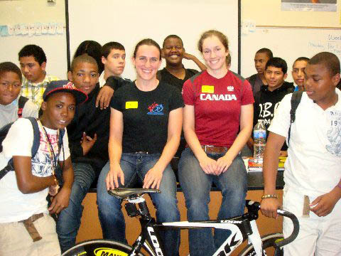 "Canadian track team riders Tara Whitten and Monique Sullivan visited an ""inner-city"" high school in Los Angeles (probably not too far from LA Velodrome) to get kids interested in bike racing.  Check the kid on the right keepin' it real!  Read the full article at Canadian Cyclist."