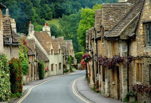 sallygator:  Castle Combe, Cotswolds. I ran across this village in the travel section earlier today. I wish I could spend the day nestled in a tea room there, reading Harry Potter and sipping Earl Grey.