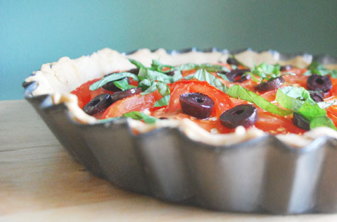 TOMATO, OLIVE & GOAT CHEESE RUSTIC TART ON BALSAMIC CRUST Serves 4 This is a wonderful yet simple tart. Ideal for lunch or a light dinner, served with a fresh seasonal tossed salad. These juicy tomatoes melt over a creamy layer of goat cheese, topped with julienned basil, toasted pine nuts, a drizzle of olive oil and black olives which serve as the contrasting ingredient in both flavor and color. As for the crust, I decided to elaborate on a basic tart dough recipe by adding balsamic vinegar, which compliments the flavor of tomato very well.  A tart pan with scalloped edges is not necessary, any shallow pan will do. As always, I highly recommend using the freshest ingredients you can get your hands on.  3/4 cups flour