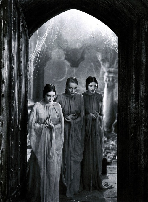 "Dorothy Tree, Geraldine Dvorak, & Cornelia Thaw as Dracula's brides in Dracula (1931, Tod Browning) (via Sin in Soft-Focus: Pre-Code Hollywood) ""I was not alone. The room was the same, unchanged in any way since I came into it; I could see along the floor, in the brilliant moonlight my own footsteps marked where I had disturbed the long accumulation of dust. In the moonlight opposite me were three young women, ladies by their dress and manner. I thought at the time that I must be dreaming, for though the moonlight was behind them, they threw no shadow on the floor. They came close to me and looked at me for some time and then whispered together. Two were dark and had high aquiline noses like the Count's, and great dark, piercing eyes that seemed almost red when contrasted with the pale yellow moon. The other was fair, fair as can be, with golden hair and eyes like pale sapphires. All three had brilliant white teeth that shone like pearls against the ruby of their voluptuous lips. There was something about them that made me uneasy, some longing and at the same time some deadly fear. I felt in my heart a wicked, burning desire that they would kiss me with those red lips. They whispered together,  and then they all three laughed, such a silvery, musical laugh, but as hard as though the sound never could  have come through the softness of human lips.  It was like the intolerable, tingling sweetness of waterglasses when played on by a cunning hand. The fair girl shook her head coquettishly, and the other two urged her on. One said: ""Go on! You are first, and we shall follow; yours is the right to begin."" The other added: ""He is young and strong; there are kisses for us all."" -Bram Stoker, Dracula (1897)"