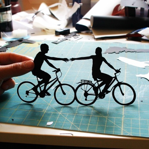 bookspaperscissors:  Couple on Bikes HandCut Paper Silhouette 8x10 by papercutsbyjoe An ideal gift for a first anniversary (traditionally made from paper)!