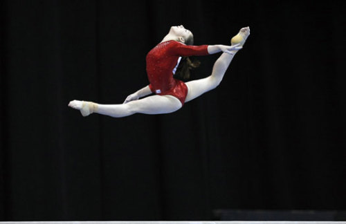 Aliya Mustafina is concurrently powerful and graceful in red, but she only sees gold.