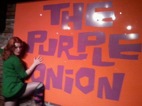 Kat Bryson molesting the Purple Onion sign. First time funzies. Photo by Kat's Mom.