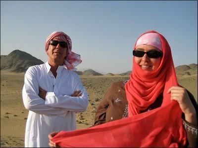 Danya Alhamrani's beautiful red scarf in the hot Saudi desert, is where form meets function when it comes to garb.