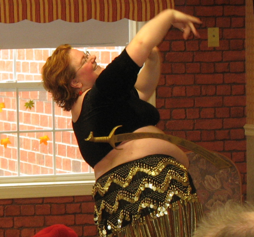 April D Enjoying her life as a fat woman (she is belly dancing in this picture)
