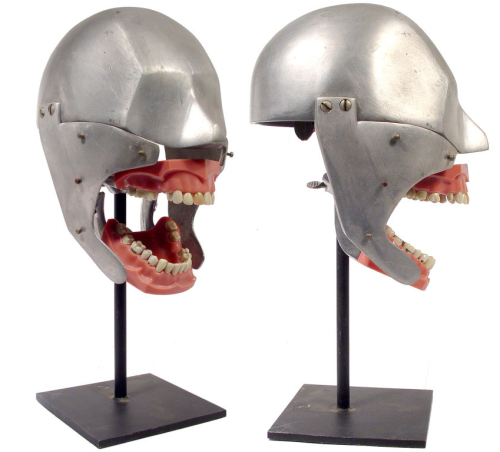 Dental Head. This is a teaching and practice device used by dental school  students. It's life sized and was a stand in for the real patient. Found here.
