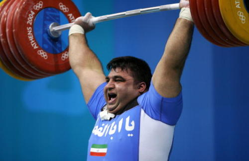 Hossein Rezazadeh is seen here wearing over 200 kilograms (440 pounds). He was later spotted walking around the streets of Athens wearing gold.