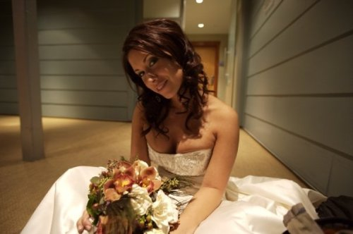 Just found this photo from a wedding I did a couple years back.. I did her cut, color, and style.