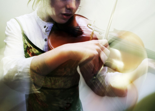 A woman playing the violin