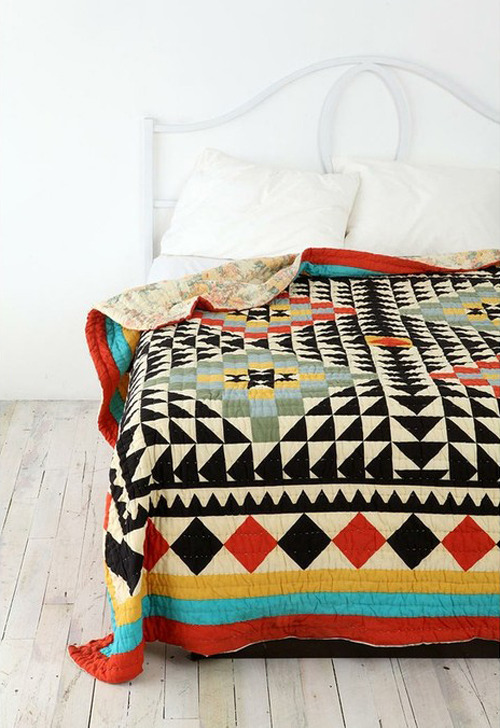 love the graphic/geometric look of this quilt. and the black & white with a pop of bold colour. batixa:  a beautiful quilt | the style files
