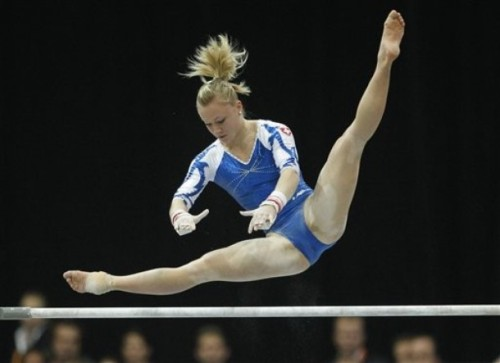 Ariella Kaeslin on bars during the all-around at the 2010 World Championships