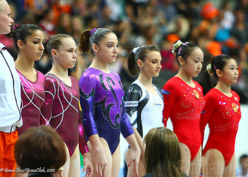Aly Raisman, Rebecca Bross, Aliya Mustafina, Ana Porgras, Huang Qiushuang, and Jiang Yuyuan line up at the start of the all-around at the 2010 World Championships love this top group :) (photo by Grace Chiu/Inside Gymnastics)