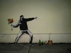 "thedailywhat:  Kickass Cosplay of the Day: Dressing up as Banksy's ""Flower Chucker"" has been done before, but this is certainly the superior execution. [thd.]"