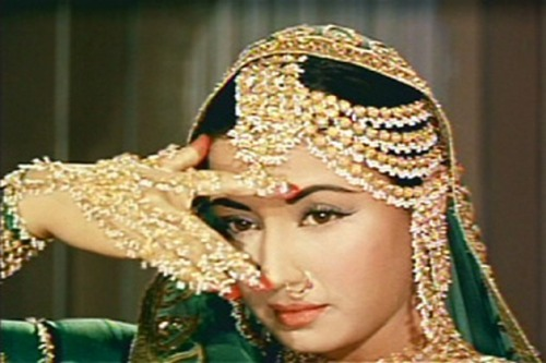 Meena Kumari, glamorously garbed in green and not an insignificant amount of gold bling.