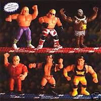 WWF Hasbro figures  I had BOXES of these. They looked cool as shit but they didn't move well. And by well I mean at all. Why won't you let Razor Ramon walk?!?? a goddamn Sharpshooter isn't a Sharpshooter if legs aren't crossed!!!