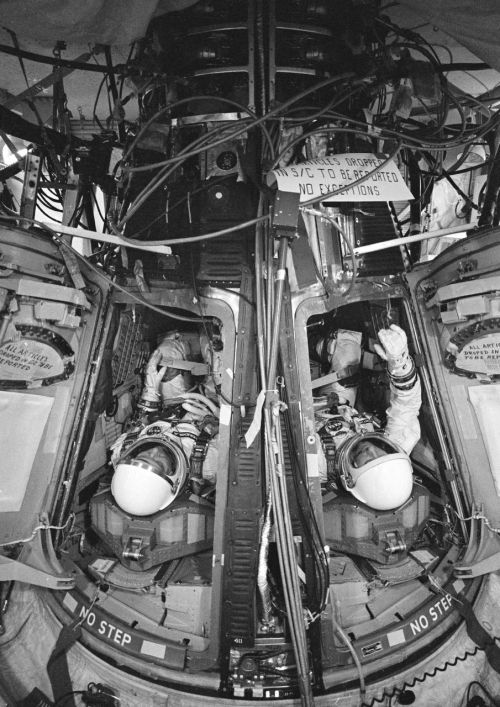 crookedindifference:  Astronauts Stafford and Schirra check out the Gemini 6 spacecraft