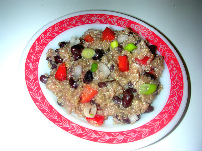 Black Bean, Red Pepper and Quinoa Salad I do believe that once you have it, you have to have more.  It is sort of like what they about tattoos. Ingredients: 1 cup Dry Quinoa2 cups Vegetable Broth1 can Black Beans, drained1 Red Bell Pepper, chopped2 Green Onions, chopped1/2 Shallot, finely choppedDressing:2 tsp Raw Honey1/2 Lime. juiced2 Tbsp Rice Vinegar2 Tbsp Flax Seed oil1 Tbsp Ground Flax Seeds2 tsp SaltInstructions:   Add broth and quinoa into a pot and bring to a boil.  Reduce heat and simmer for about 15 minutes, till liquid is absorbed. Set aside to cool.In a jar combine honey, lime juice, rice vinegar, flax seed oil, ground flax seed and salt; shake to mix. In a large bowl combine quinoa, black beans, bell pepper, and onions; drench with dressing.  Mix thoroughly to distribute the dressing.  Chill before serving.