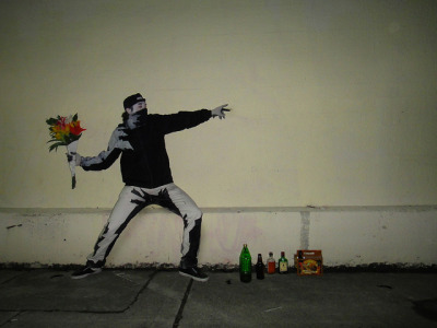 naveen:  so genius dude does banksy flowerthrower costume for halloween Banksy Ghost Ship Warehouse Wall (by George Schnakenberg III)